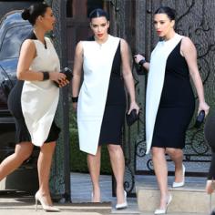 Kim Kardashian looks pregnant! Oh, that's because she IS pregnant, duh.
