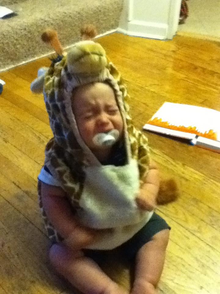 He is in a giraffe costume.