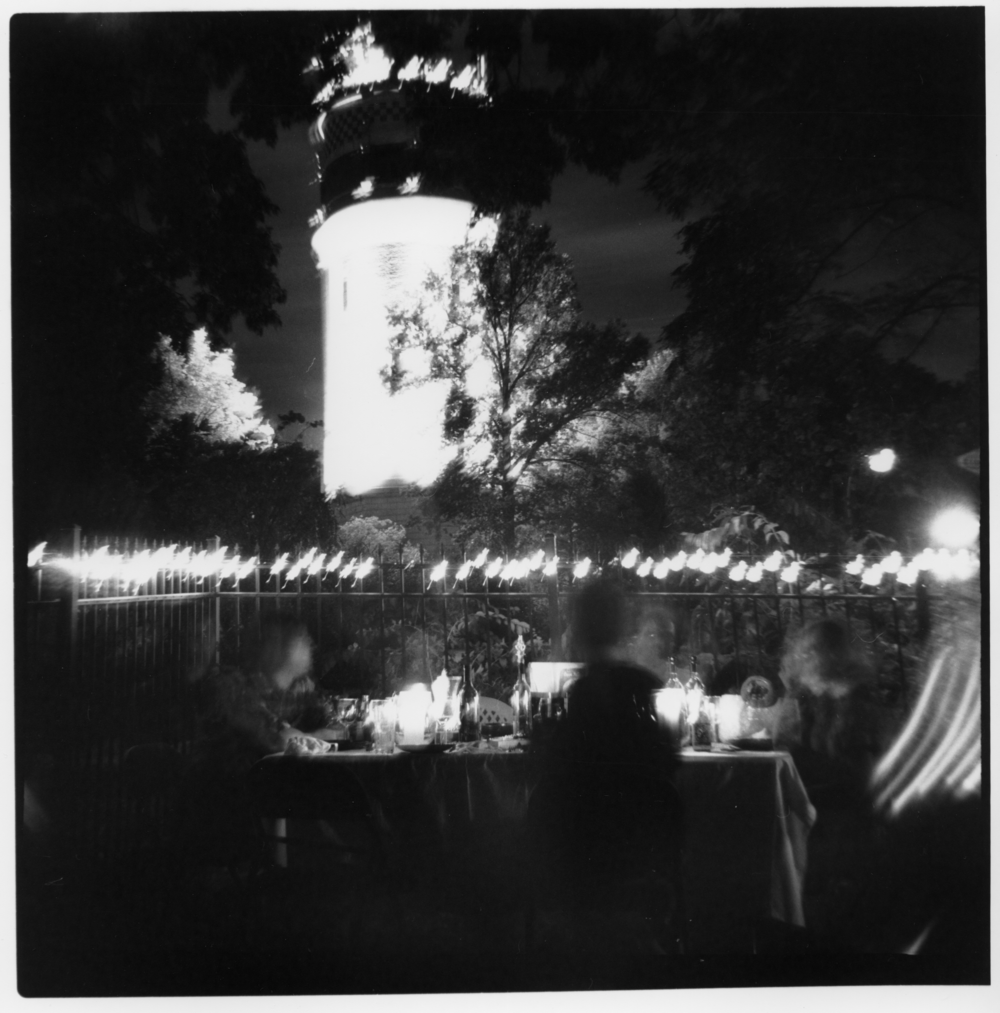 Three minute exposure using my Yashica-Mat 124G, Ilford HP5 film, tripod, and manual Bulb setting held down with a hair clip. I framed the shot, locked down the shutter, and just walked around for three minutes. I believe I even went to my seat (on the left) and had a sip of wine before going back to the camera. I love the movement in this shot. Conversation, literally, in action.