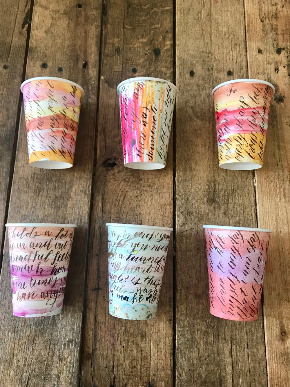 mixed media art on coffee cups, watercolor and calligraphy