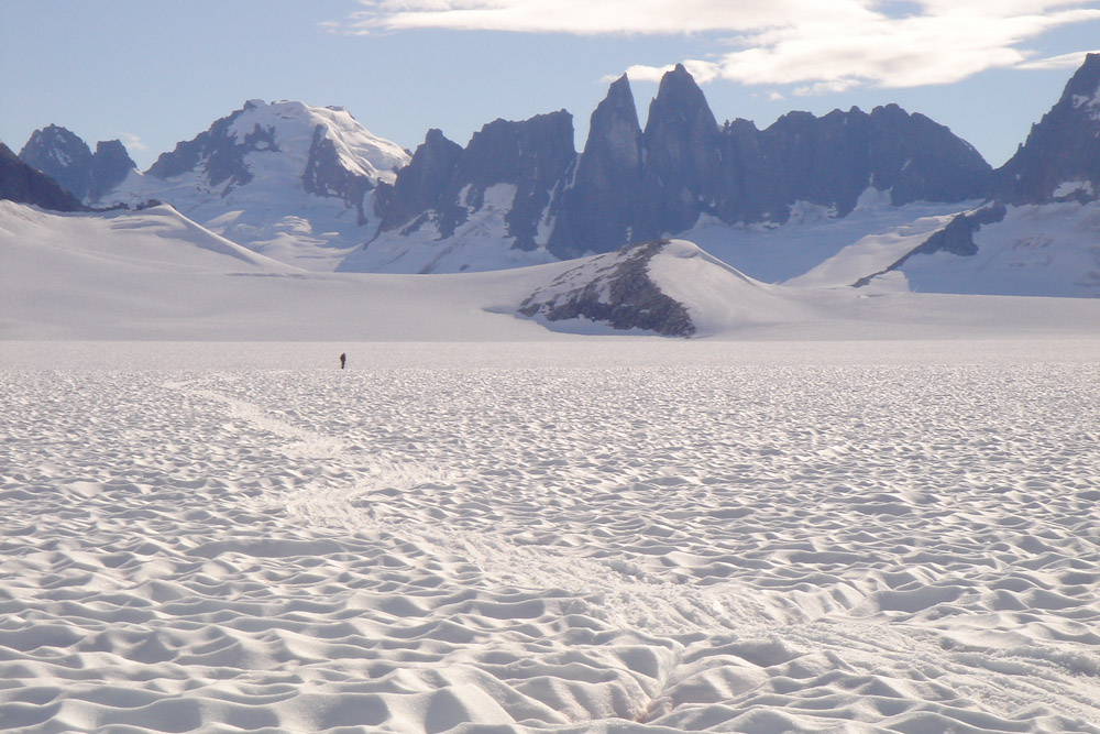 Professor Phil Druker (U. Idaho) enjoys the desolation of the Juneau Icefield, July 2005.  Photo:  M. J. Beedle