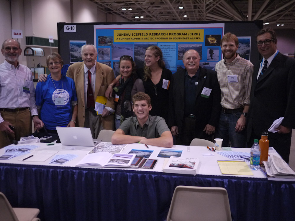 A multi-generation crew of JIRPers at the 2011 Geological Society of America Annual Meeting.  From left to right:  Dr. P. Jay Fleisher, Judy Pachter, Dr. Maynard Miller, Kate Baustian, Kent Walters, Coco Loehr, Dr. Bruce Molnia, Matt Beedle, and Toby Dittrich.  Photo:  M. J. Beedle