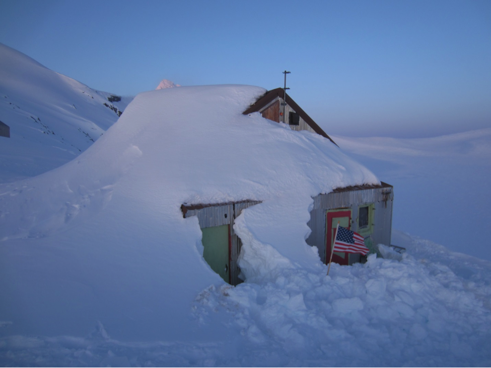 "The ""Cookshack"" at Camp-10 on the Juneau Icefield, after digging for quite some time to unbury it from meters of snow.  Photo:  C. McNeil"