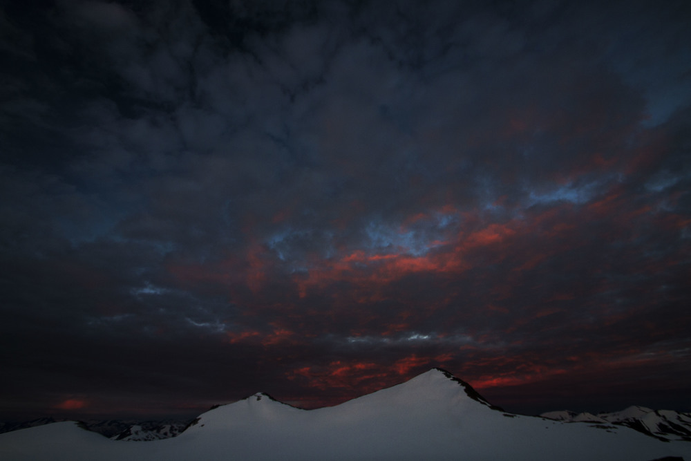 As the sun sets over Juneau, Observation Peak is set on fire from the glow of the clouds.  Photo:  Adam Taylor