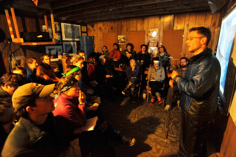 Dr. Anthony Arendt gives an evening lecture to JIRP students in the Camp 17 library.  Photo:  Jeff Barbee