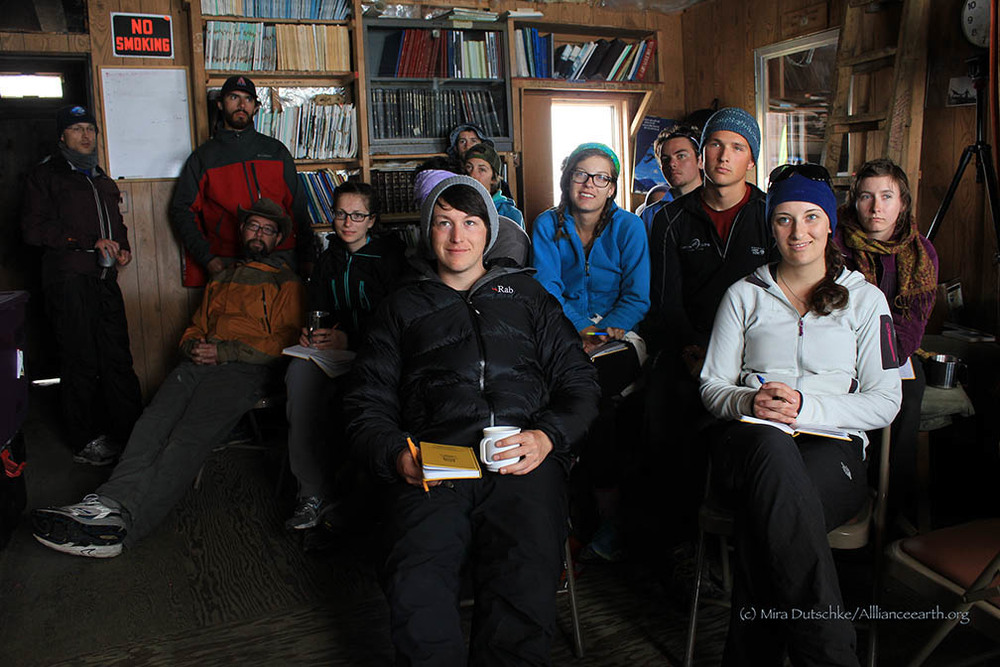 Learning about snow pits and the science of glacier mass balance in the Camp 17 Library.  Photo:  Mira Dutschke