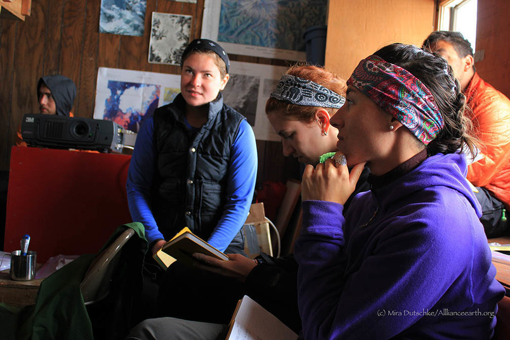 Jamie Bradshaw, Leah Nelson and Mary Gianotti in a lecture on glacier mass balance in the Camp 17 Library.  Photo:  Mira Dutschke
