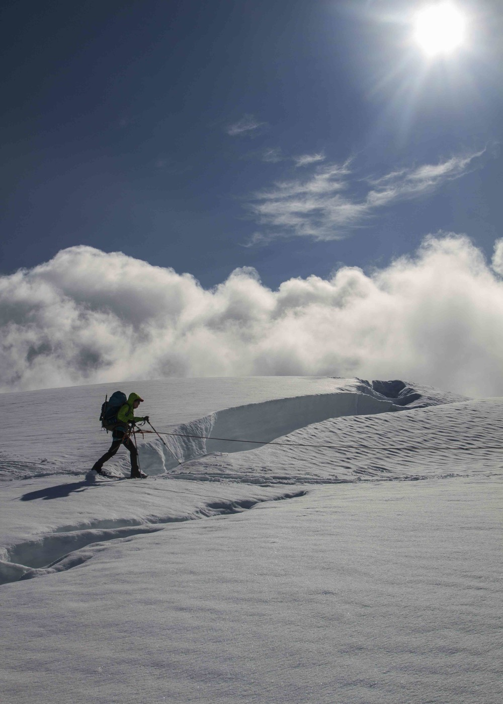 Sarah Cooley skis by a crevasse during the descent from Nugget Ridge.  Photo by Adam Taylor.