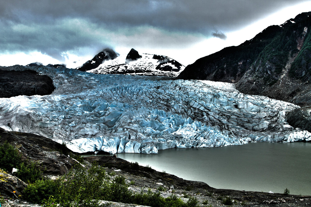 The rivers of ice we know as glaciers form from the accumulation of enormous quantities of snow.  Mendenhall Glacier, Alaska.  Photo by Adam Taylor