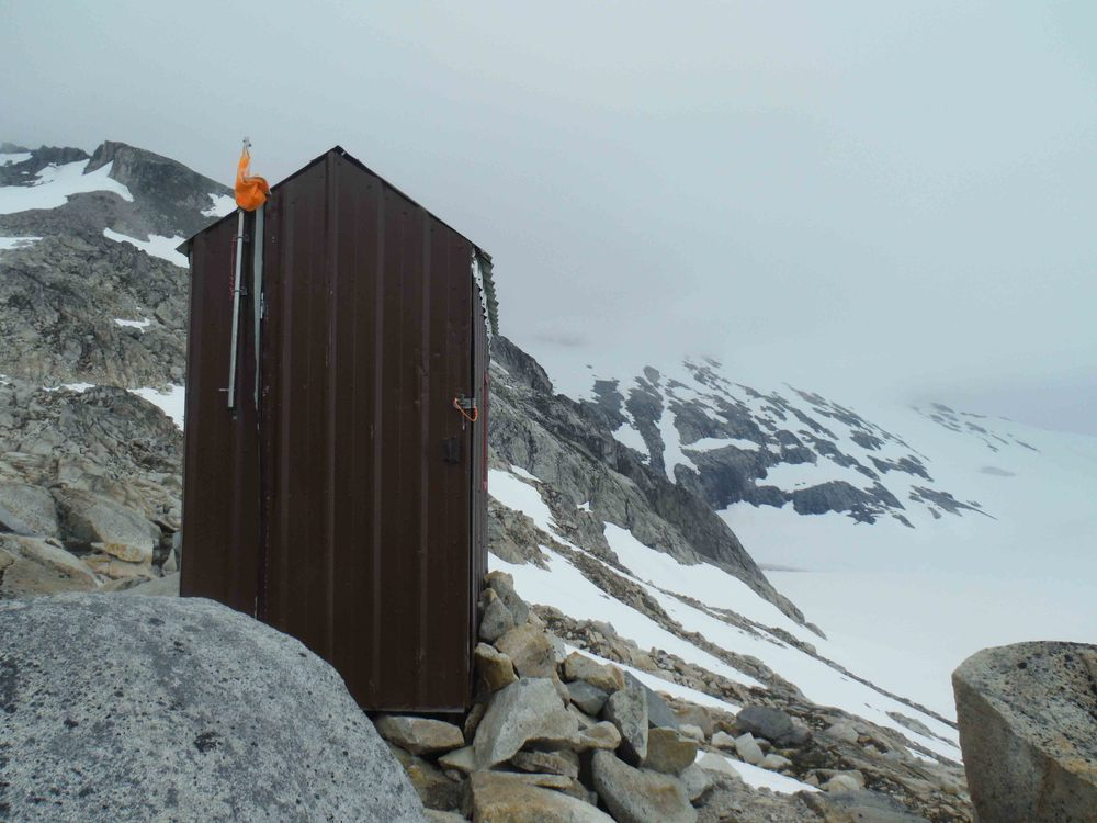 "The ""Bomb Shelter"" at Camp 10.  This small shed used to be in a different location at Camp 10 and actually was used to store . . . well, bombs, used in seismic reflection studies of glacier thickness.  In recent years it has been recommissioned as an outhouse.  Photo by Sarah Bouckoms"