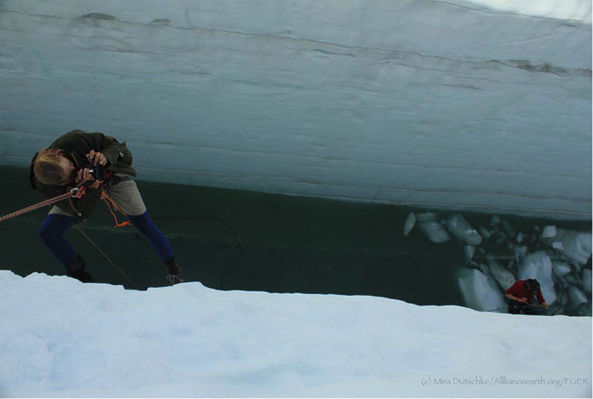 Some of us decided to explore the crevasse further down.  Here Alistair Morgan is filmed by Jeffrey Barbee.  Photo by Mira Dutschke