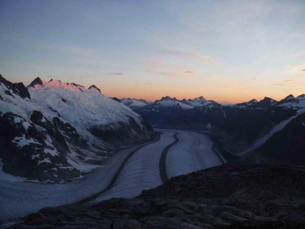 After a long day of skiing from Camp 10 to Camp 18, the sun sets on the glaciers and peaks of the Gilkey Trench.  Photo by Sarah Bouckoms.