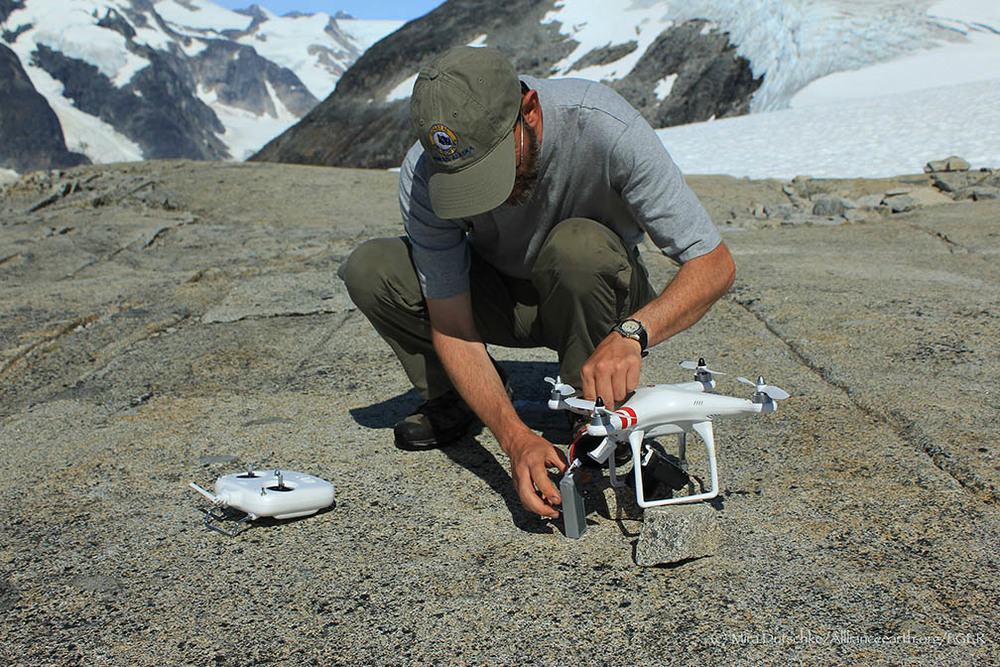 Paul Illsley sets up his quadcopter for a aerial photography flight over the Camp-18 nunatak.  Photo by Mira Dutschke