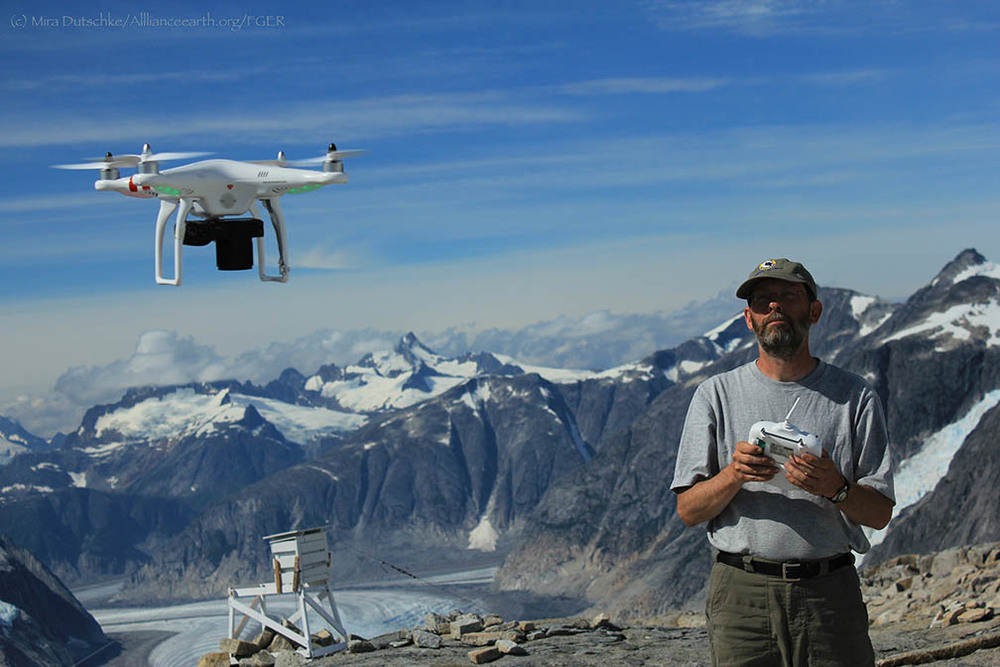 Paul Illsley begins a flight with the quadcopter at Camp 18.  Photo by Mira Dutschke.