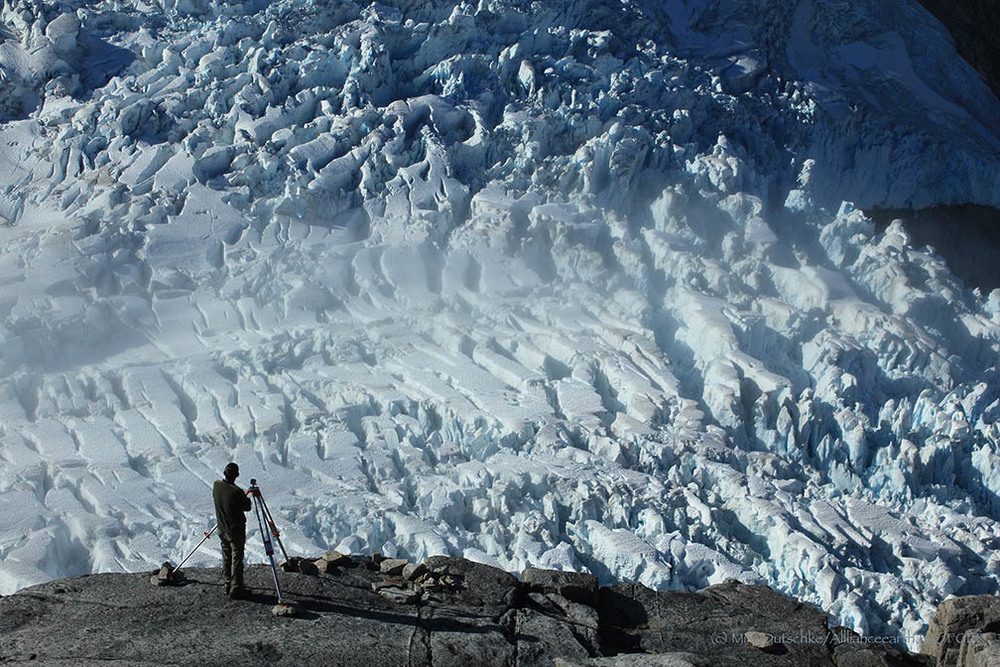 Paul Illsley at a terrestrial photogrammetry station overlooking the Vaughan Lewis Glacier.  Photo by Mira Dutschke.