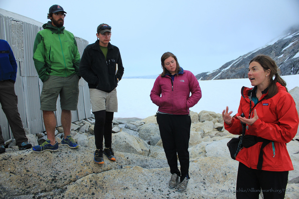 "Dr. Polly Bass talking with JIRP students, Patrick Englehardt, William Jenkins and Mary Gianotti, about the geobotany of the ""Taku B"" nunatak on the Taku Glacier in Southeast Alaska. Photo by Mira Dutschke"