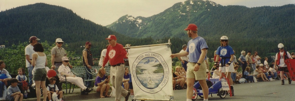 Dr. Miller and Guy Adema lead the 1999 JIRP crew in the 4th of July parade, Juneau, Alaska.  Photo by Cathy Connor.