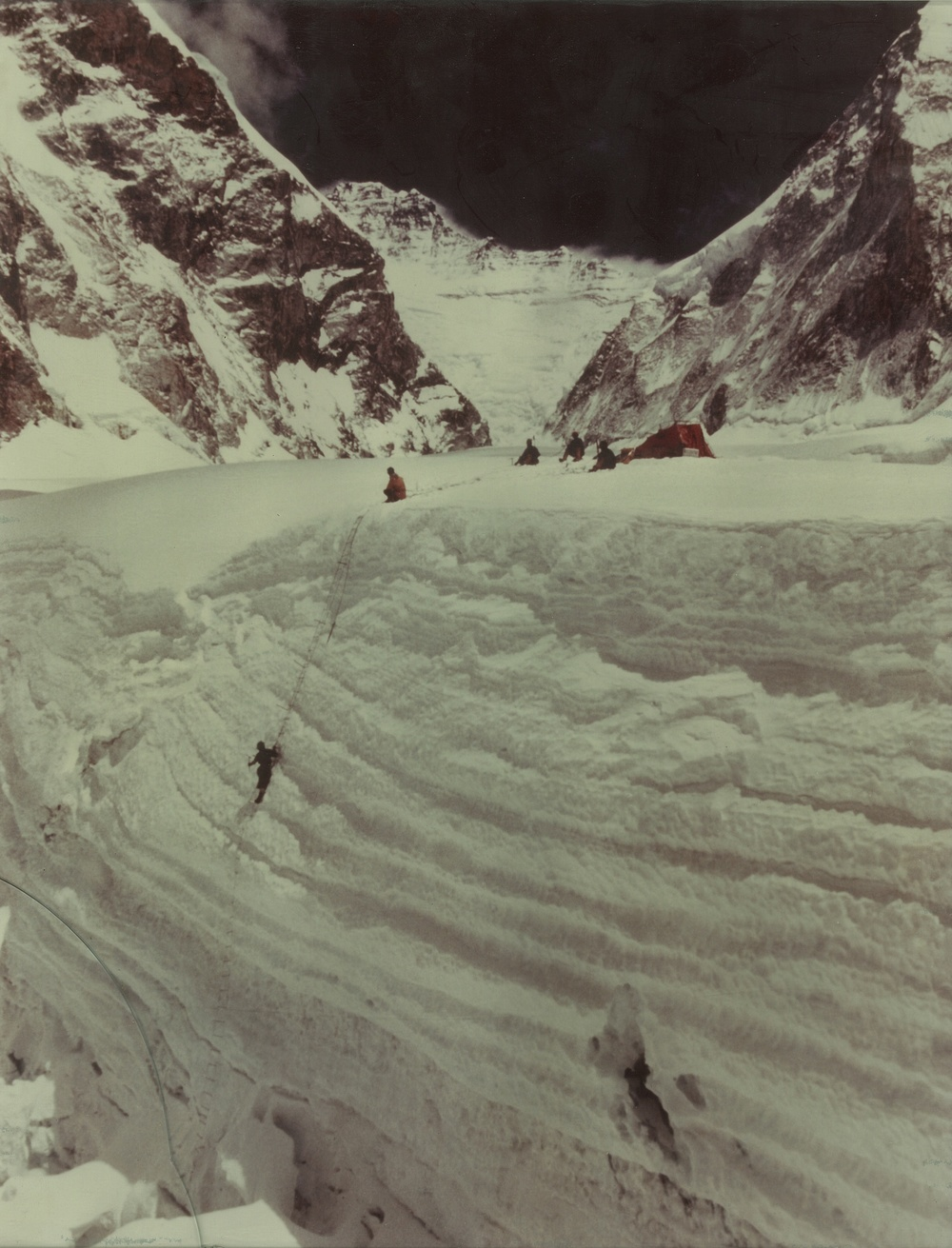 Dr. Miller and Barry Prather study historical snow accumulation of Khumbu Glacier during the 1963 US Everest Expedition.  Photo courtesy of the Miller family.