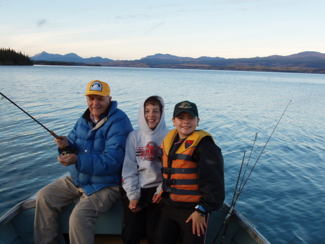 Dr. Miller fishing with grandsons Logan and Zach on Atlin Lake.  Photo by Lance Miller.