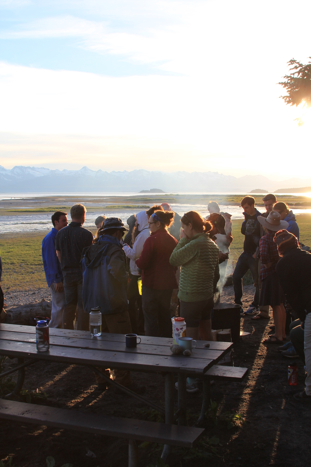 Students and JIRP alumni enjoy a barbecue on Eagle Beach in Juneau.