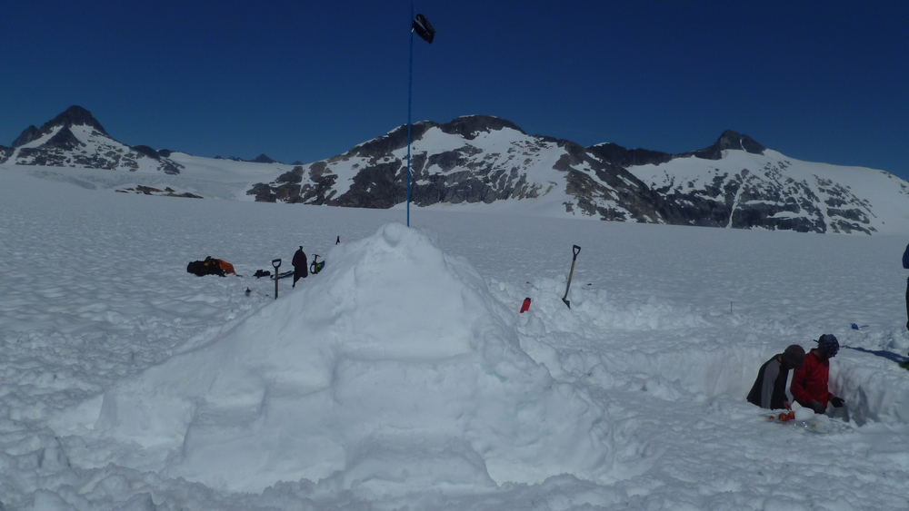 The south-facing side of the Taku glacier snow throne.  Matt P. and Alex Z. working hard digging the pit to the right of the image.  photo by Danielle B.