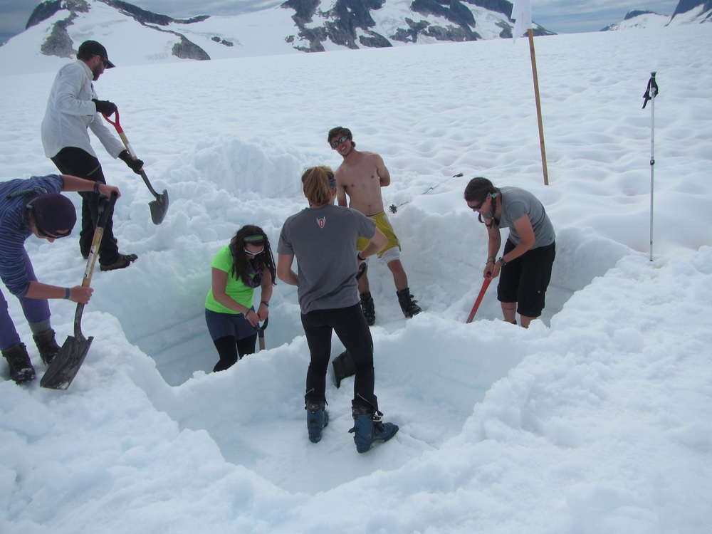 Hannah, Alex, Laurissa, Danielle, Luc, and Carmen dig a mass balance pit on the Southwest branch of the Taku glacier.  photo by Gillian Rooker