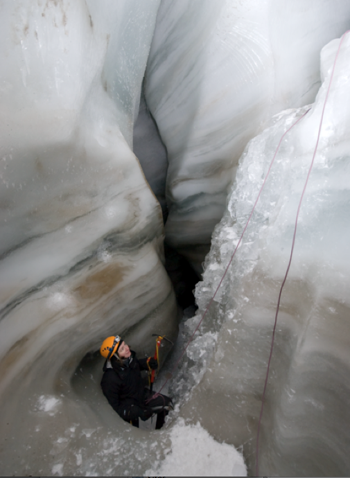 Rappelling into a glacial moulin.  (Photograph by Alexis Fagnoni)