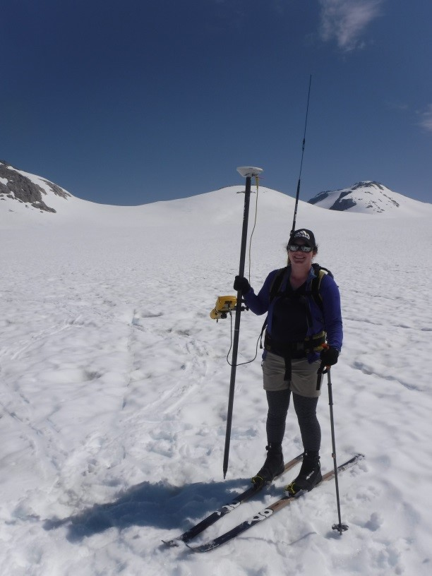Ella using the Trimble GPS to survey the Lemon Creek Glacier. Photo by Mickey MacKie.