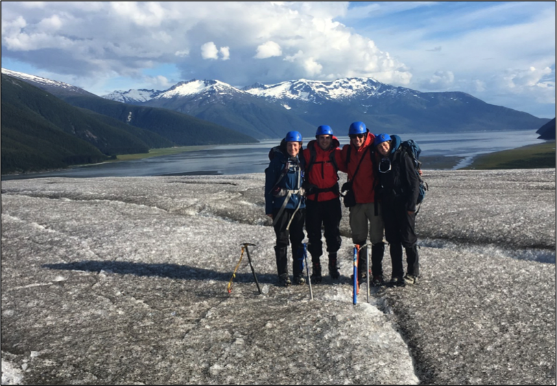 Olivia Truax, Alex Burkhart, Evan Koncewicz, and Cézy Semnacher on top of the ablation zone of the Taku Glacier.
