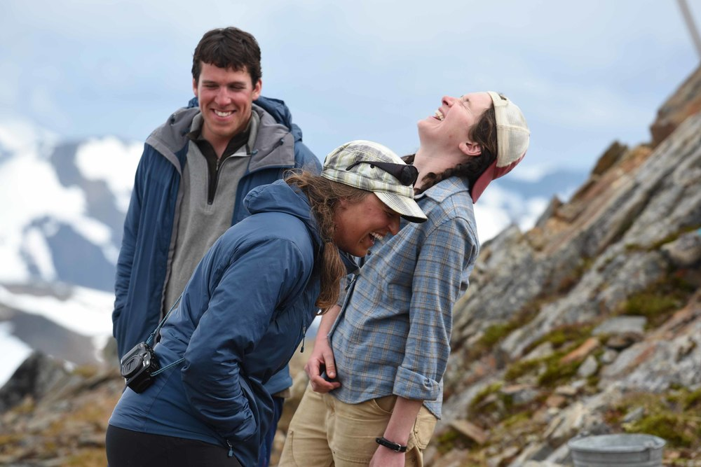 JIRP Field Staff, Matt Pickart, Allie Strel, and Annie Boucher share a laugh at Camp 17. Photo courtesy of PBJ Photography