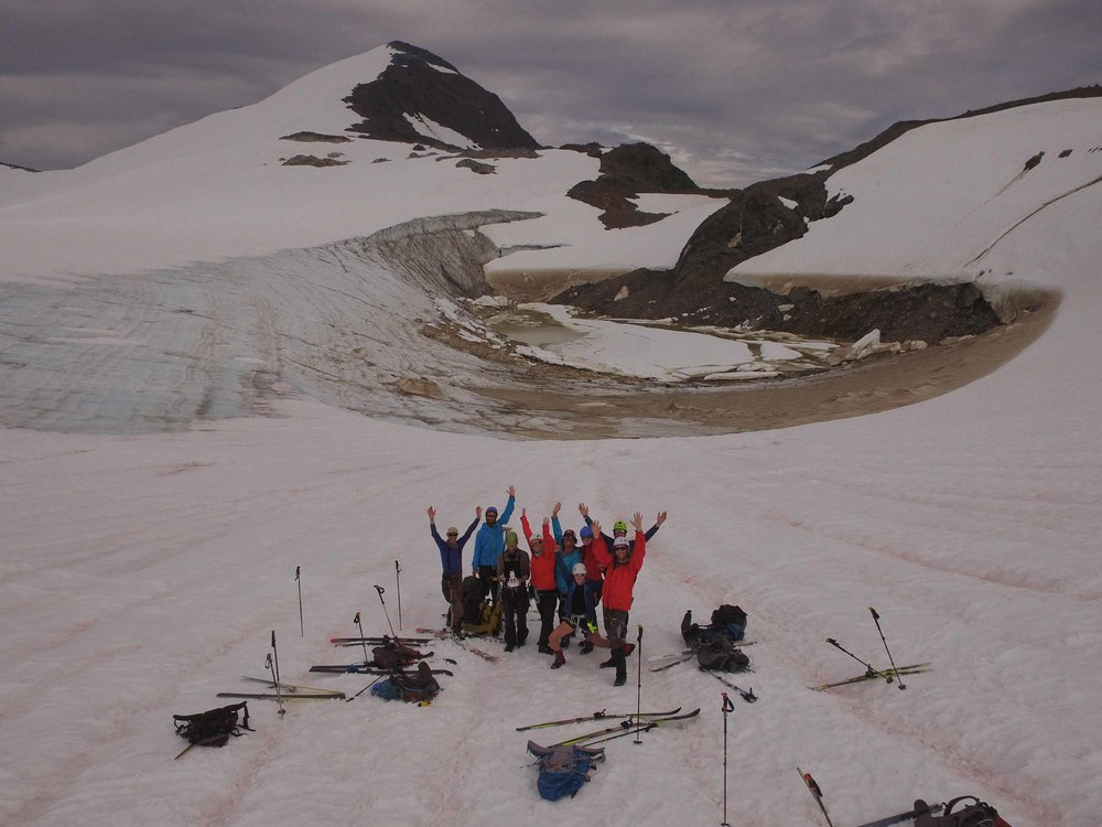 Team Drone in front of Lake Linda on the Lemon Creek Glacier. From left to right: Uwe Hoffman, Chris Miele, Matt Beedle, Deirdre Collins, Kenzie McAdams, Cézy Semnacher, Louise Borthwick, Alex Burkhardt, Lucas Beem. (Photo credit: Matt Beedle)