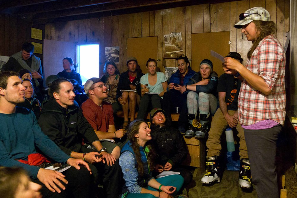 Staff member Allie Strel reads a humorous story on Expedition Behavior in the Library at Camp 17. Photo by Matt Beedle.