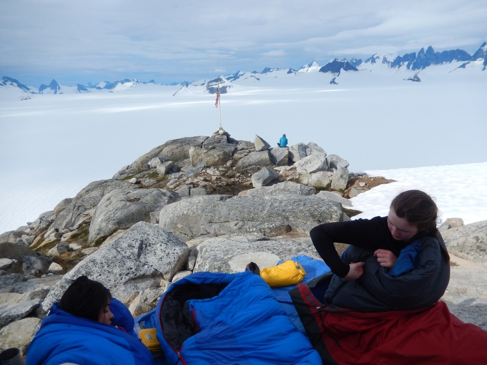 Shawnee Reynoso and Louise Borthwick sleeping out on the porch of the Camp 10 cook shack overlooking Taku Glacier. Photo: Kate Bollen