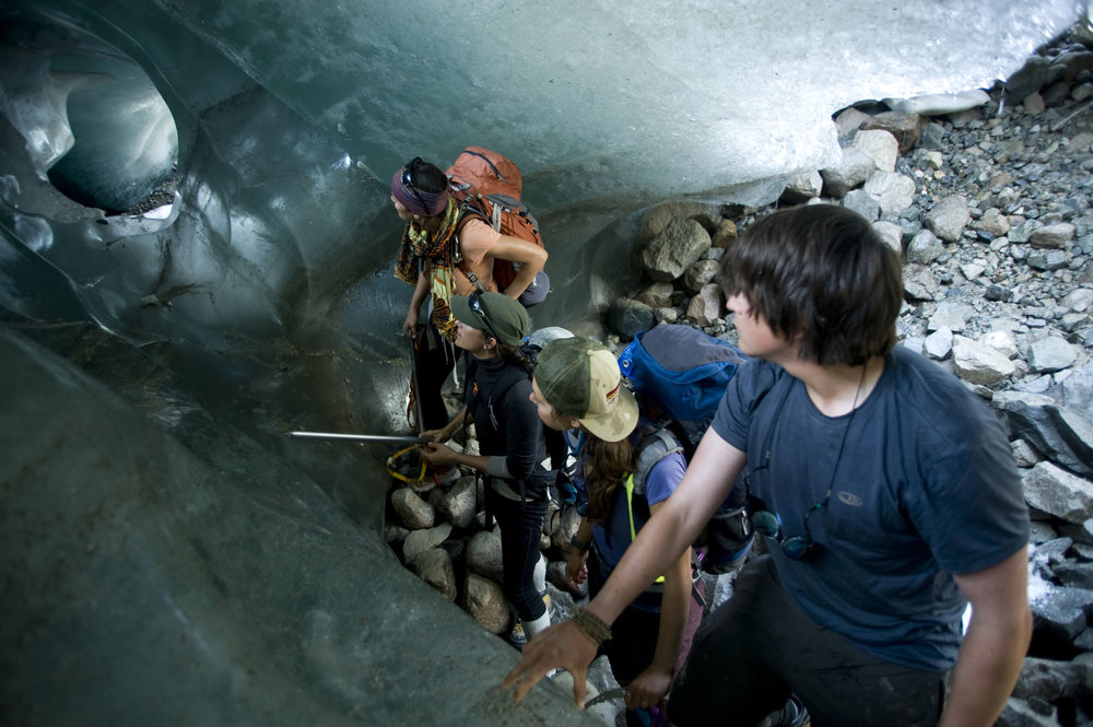 From left to right: Filmmaker Mira Dutschke, Dr. Lindsey Nicholson, researcher Brooke Stamper and researcher Alistair Morgan explore an ice cave.   Photo by Jeffrey Barbee.