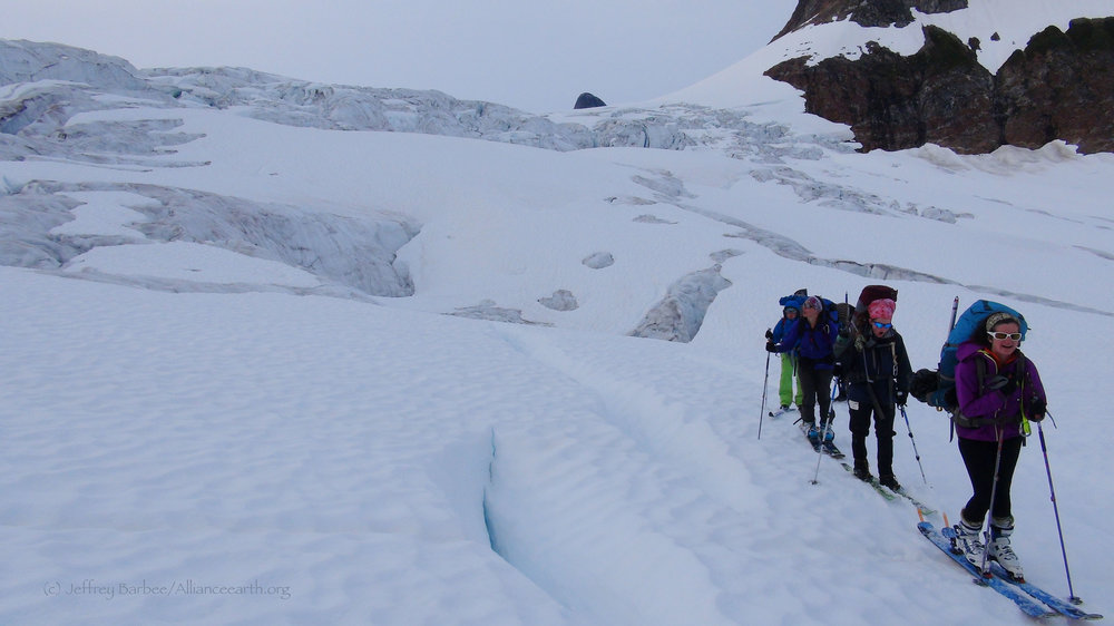 Justyna Dudek, Mira Dutschke, Sarah Bouckoms, and Chrissy McCabe navigate through an icefall. Photo by Jeffrey Barbee.