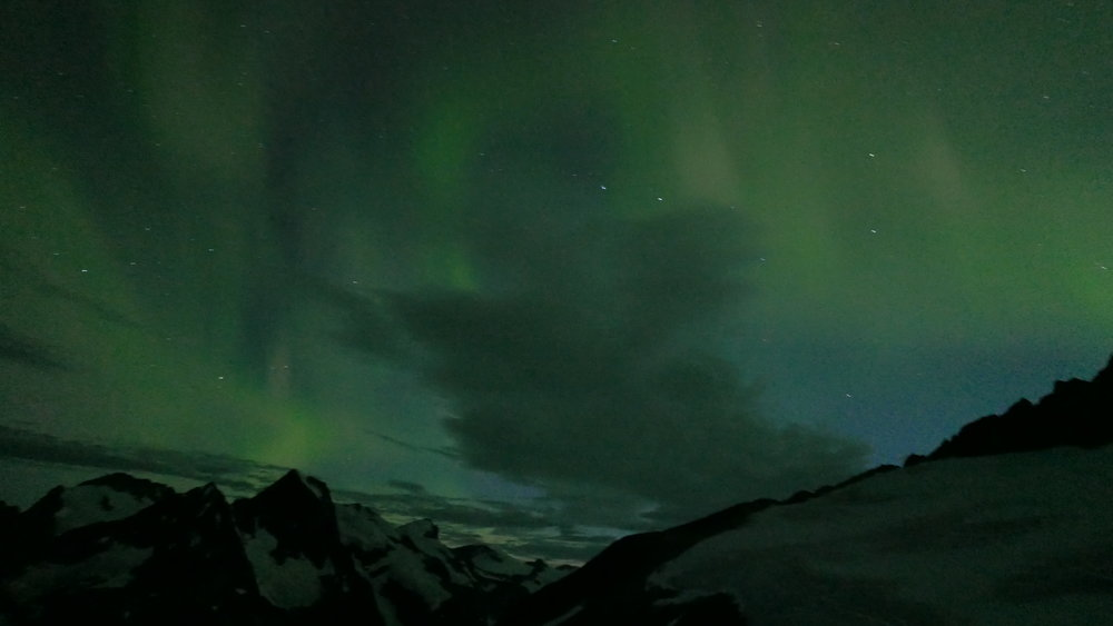 Mountains above the Gilkey Trench under the Aurora Borealis. Photo Credit: Deirdre Collins