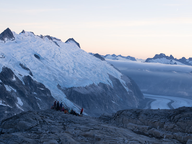 Faculty member Billy Armstrong (right, red jacket) holds an evening lecture on ice flow dynamics above the Gilkey Glacier.