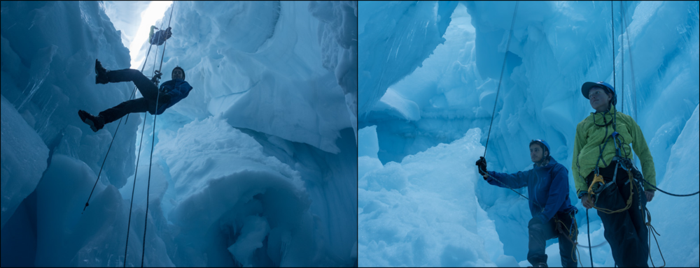 Students Matty Miller (blue jacket) and Tai Rovzar (green jacket) repel into a crevasse and observe their surroundings.