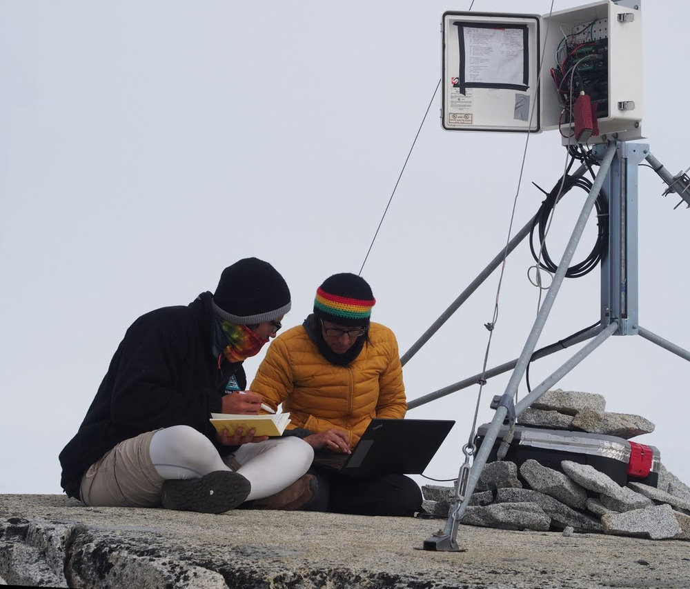 Student Joel Gonzales-Santiago and faculty member Lindsey Nicholson download meteorological data from a weather station. Photo credit: Allen Pope.