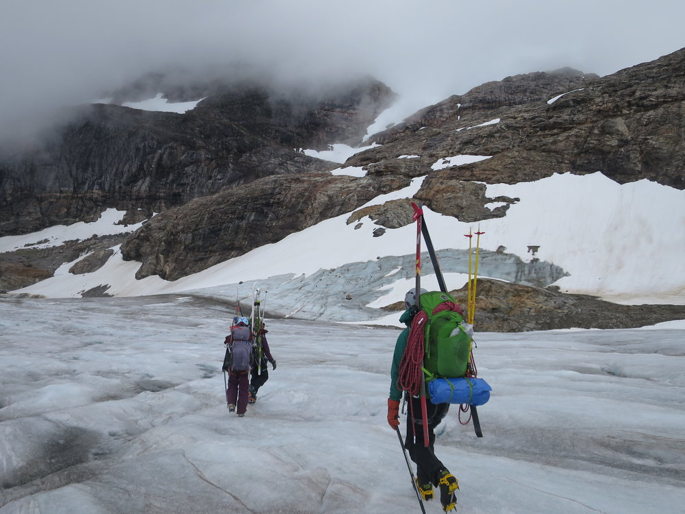 Students Zach Gianotti, Theresa Westhaver, and Ilana Casarez crossing the blue ice at the terminus of the Lemon Creek Glacier before our hike up Nugget Ridge. PC: Bryn Huxley-Reicher