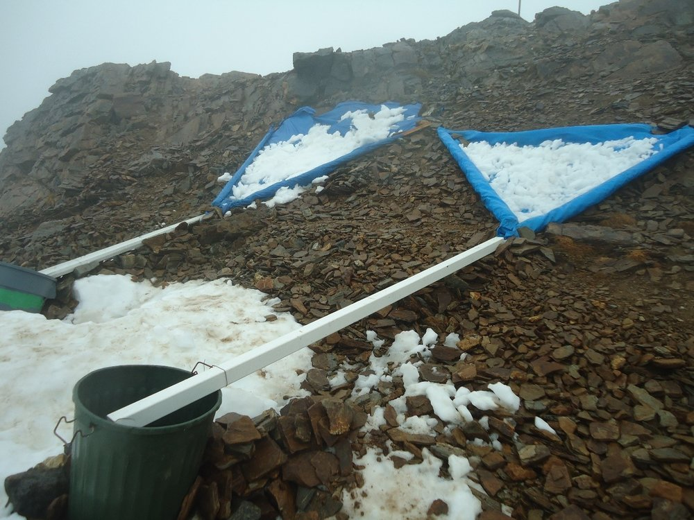 One of the first things we did upon arrival to camp was set up water collections. We did this by framing tarps with 2x4s to funnel into a gutter and then into a bin after shoveling surrounding snow onto the tarp. It's good to scrape off the top layer before shoveling, but no filtering or purifying needed! Photo credit: Kelcy Huston.