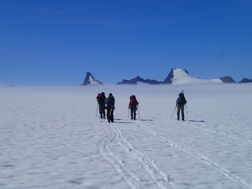 Part of the mass balance group skiing to their pit located behind Emperor Peak. Photo credit: Julian Cross.
