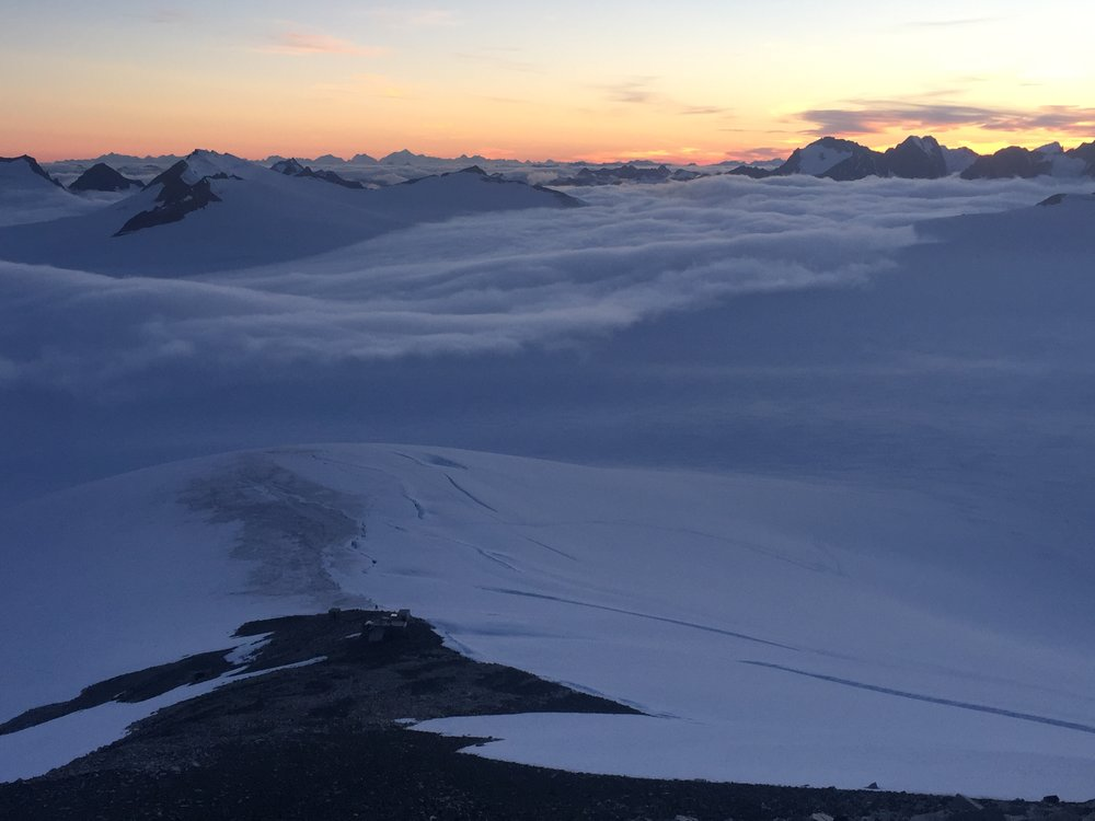 View of C8 and the upper Matthes Glacier from Mt. Moore at sunset, with C18 below the clouds. Photo: Amy Towell.