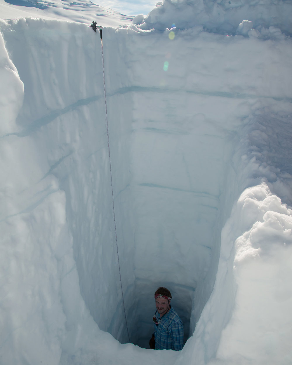 Student excavates the bottom step of a snow pit through the last year's snow accumulation. PC: Ben Huff