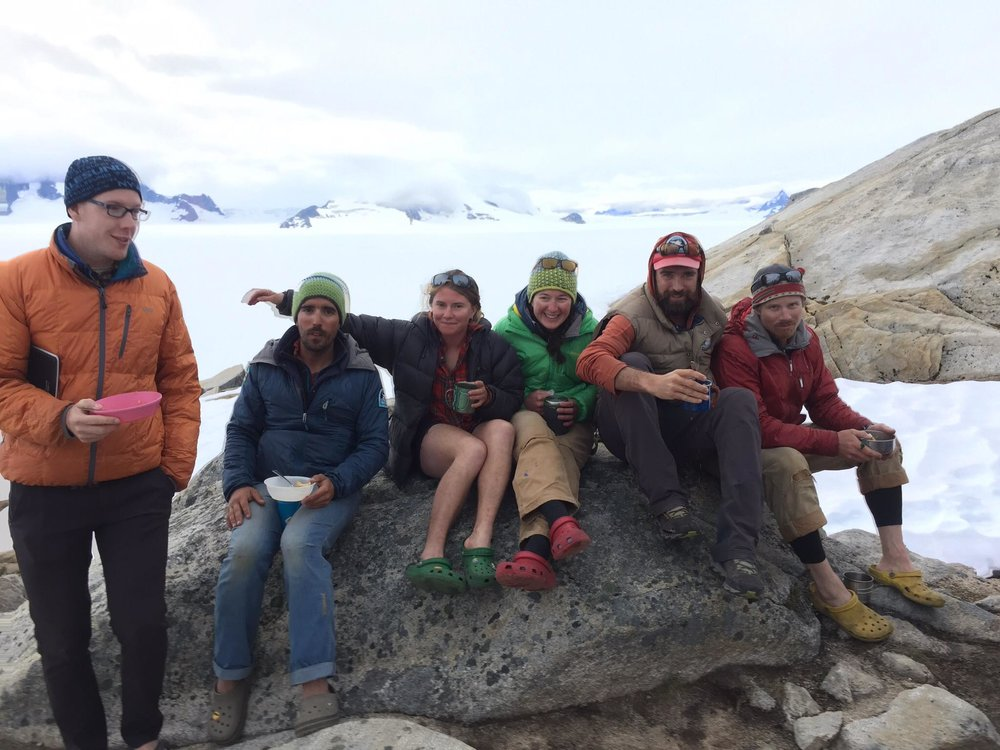 Veteran staff and faculty eat dinner in their (synthetic) puffy jackets at Camp 10. An extra puffy isn't required, but most people enjoy having one for when it gets chilly at night. Watch out for these JIRPers this summer, every one of them is full of tall tales of bad weather days on the Icefield! PC: Paul Jerard.