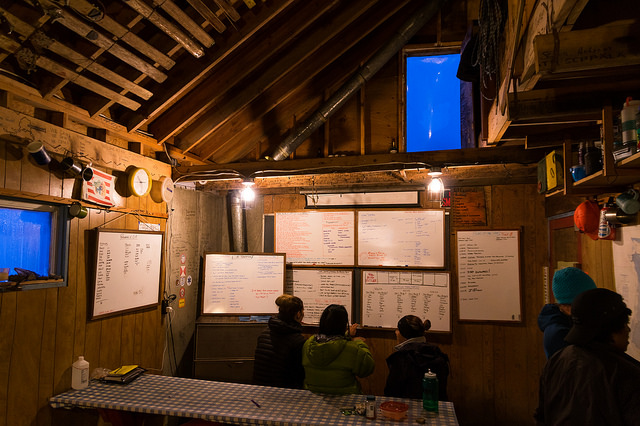 A group of students takes a few minutes to look over the scheduling whiteboards at Camp 17. The many moving pieces at JIRP require constant attention to communication, organization, and planning. Thankfully our expert staff and faculty pull it off every summer. PC: Daniel Otto.