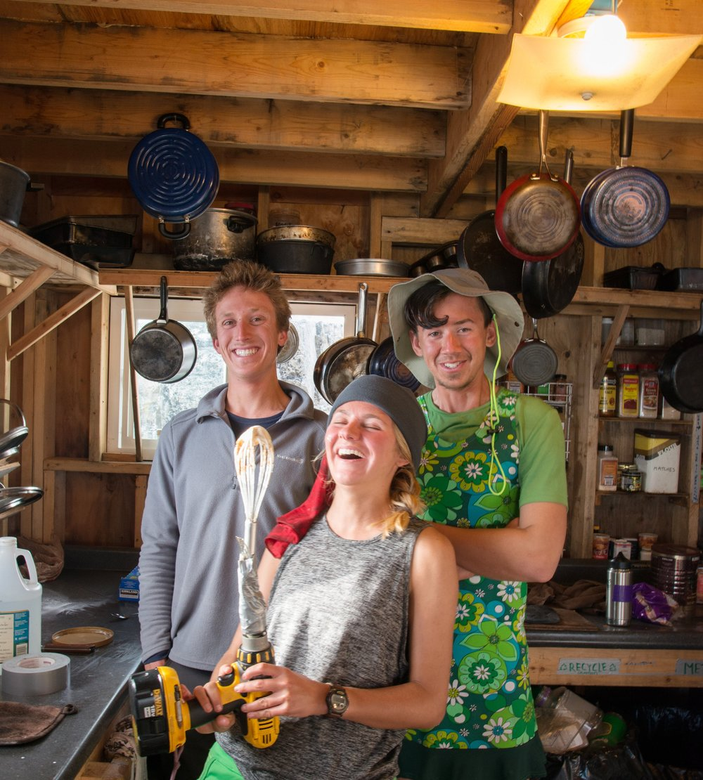 "Kyle, Lois, and Daniel, our Cook Crew for the annual ""Fancy Dinner"". Whipped cream for 55 people is no mean feat! These all-stars broke out the cordless drill to whip. PC: Ben Huff."