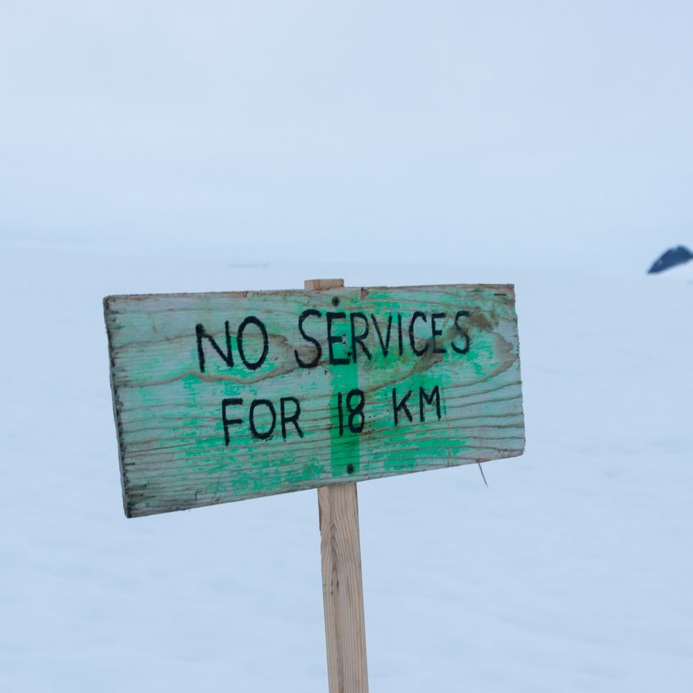 A sign along the snow machine track on Taku Glacier. No gas stations on the Icefield (except in the camp fuel shed)! PC: Daniel Otto.