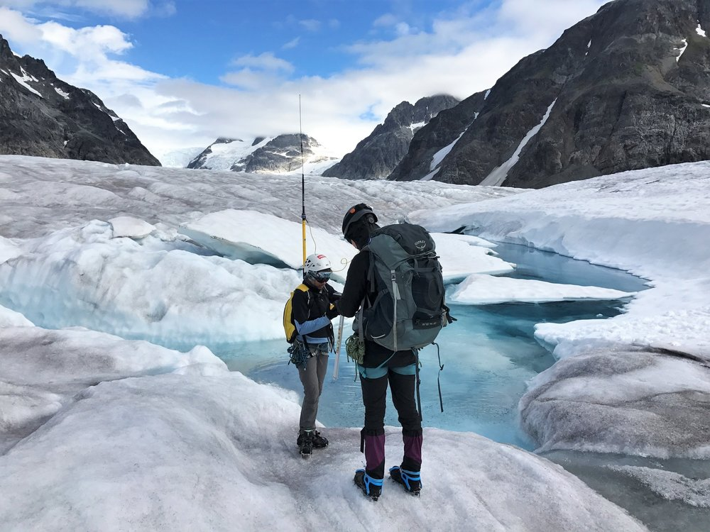Two Geomatics students use the GPS to map the ogives at the base of the Vaughan Lewis Icefall. Photo credit: Julian Cross.
