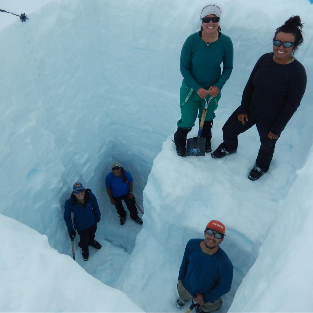 The Mass Balance student research team in a snow pit dug through one year's worth of snow.